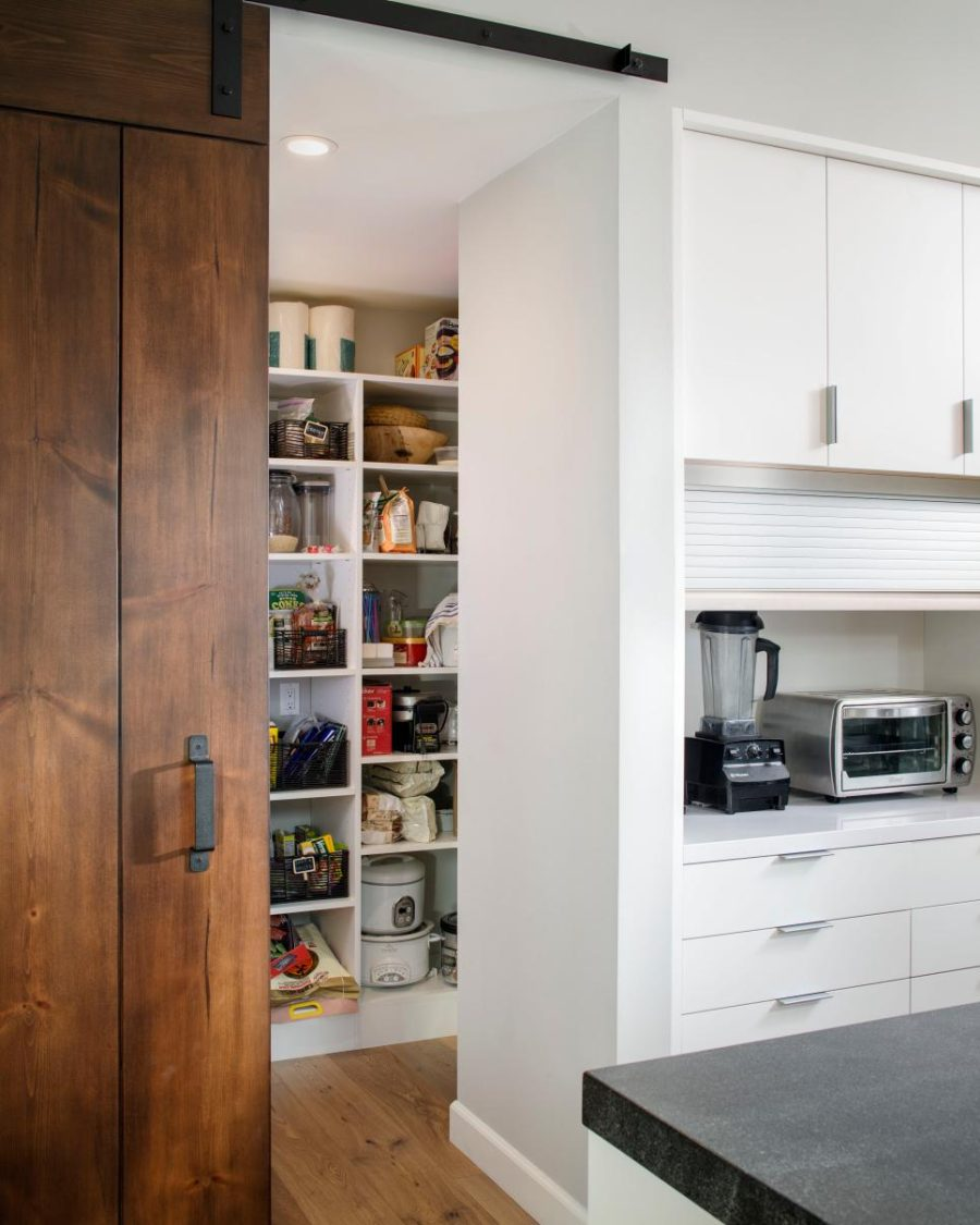 Walk-in pantry with a sliding barn door