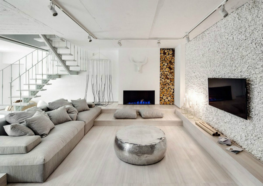 White painted river rocks make the feature wall in the living area 900x636 White Apartment in Kiev Makes a Case for Monochromatic Design