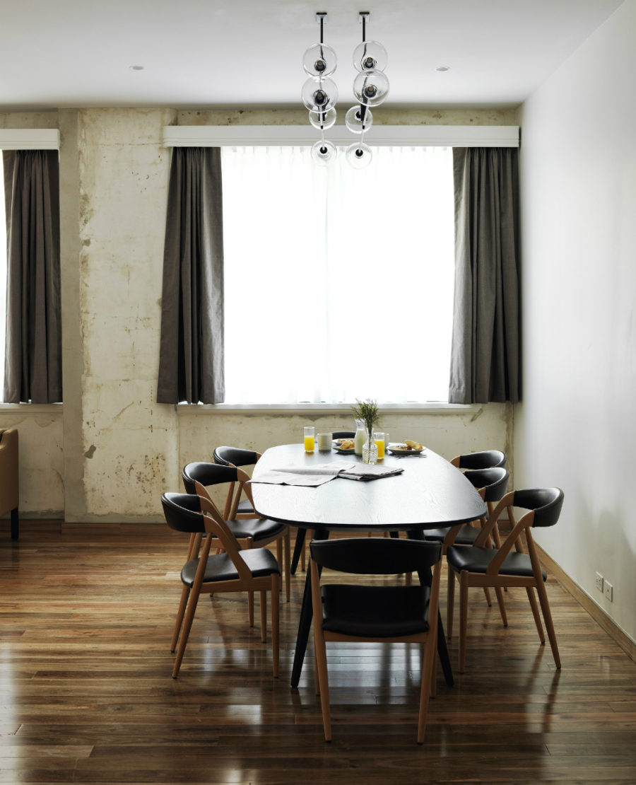 A dining area in a room with distressed walls