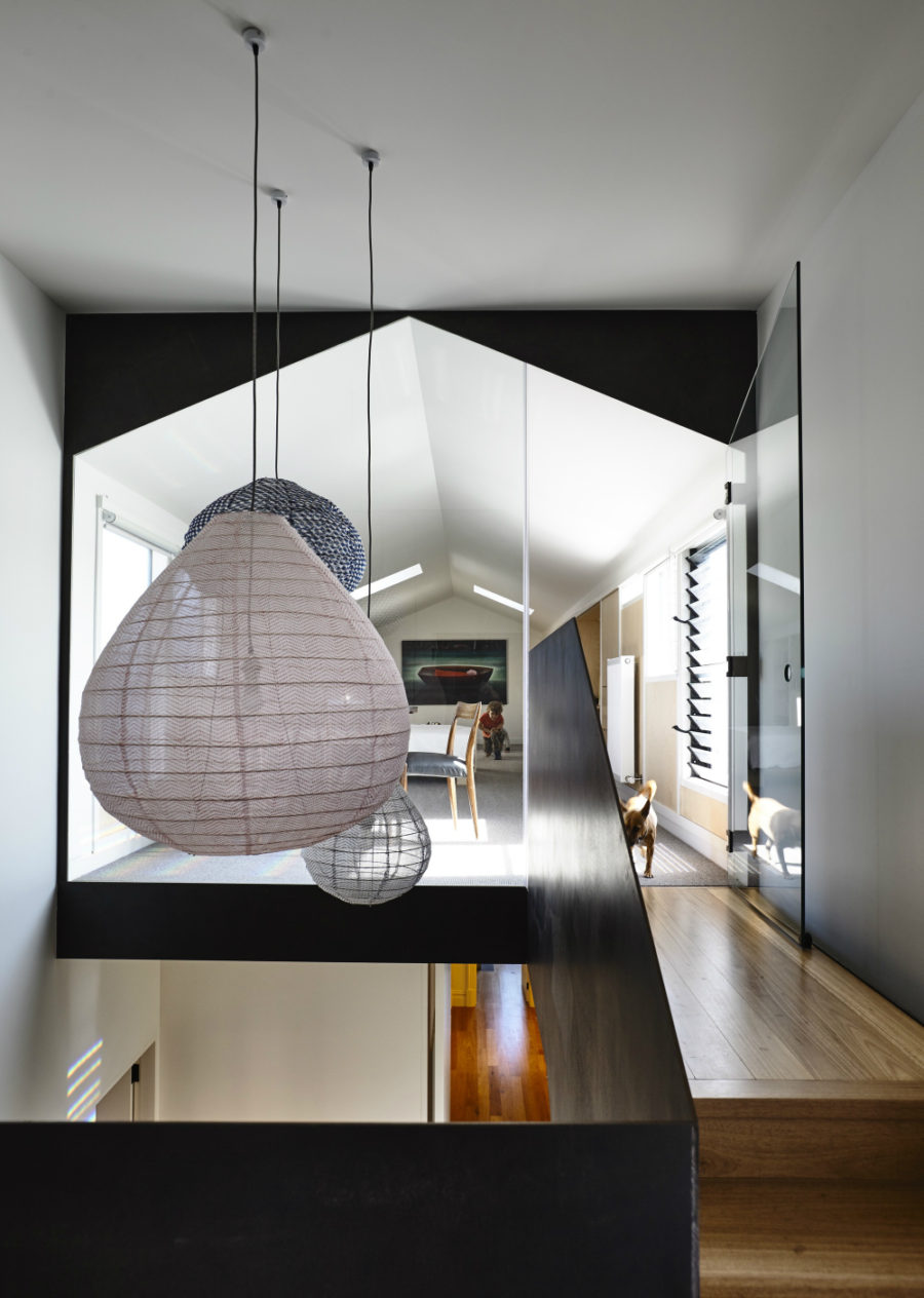 A group of different pendants illuminated and decorate the staircase