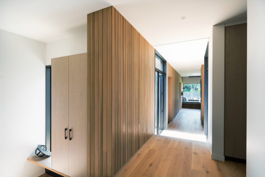 A long corridor ends with a cozy window seat