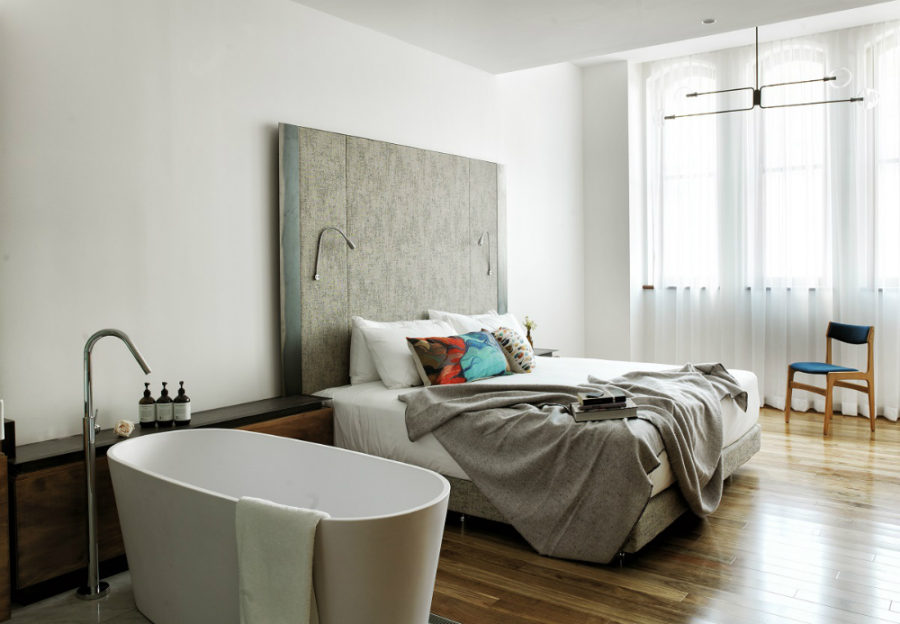 A room with a freestanding bathtub