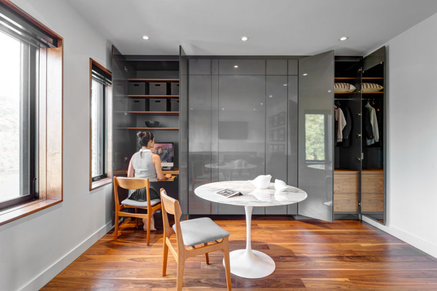 A sleek glossy closet hides a home office