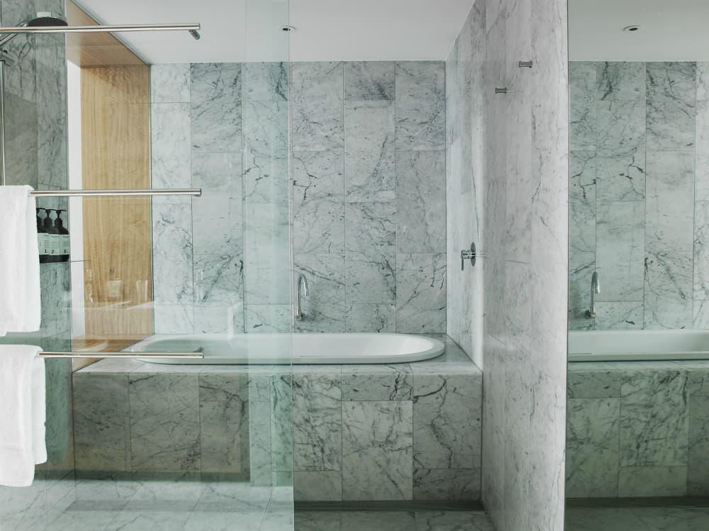 All-marble bath with a tub