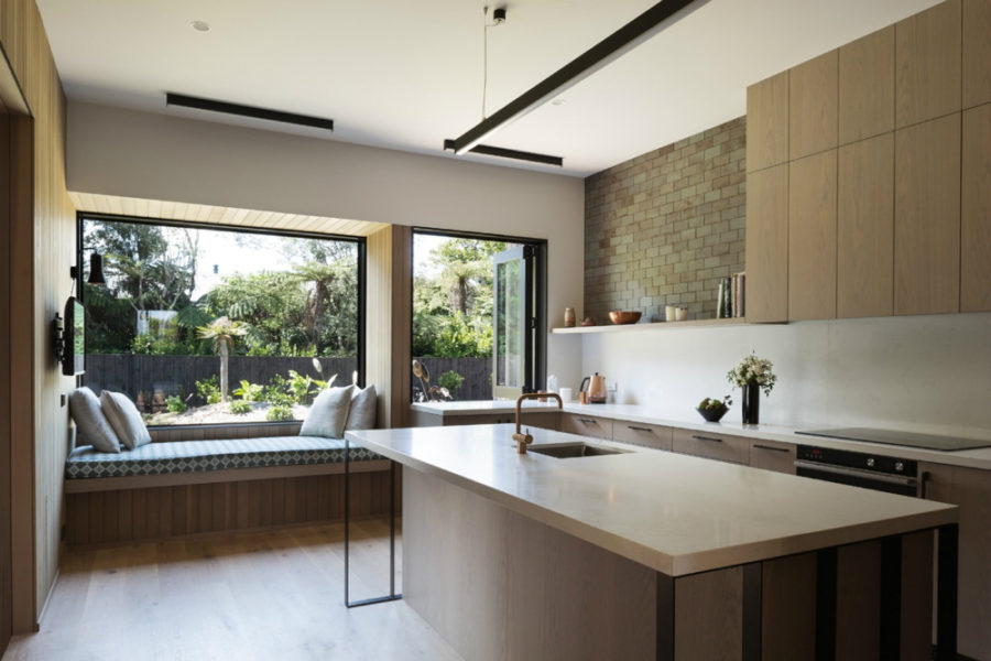 Another window seat in the kitchen overlooks the green landscape