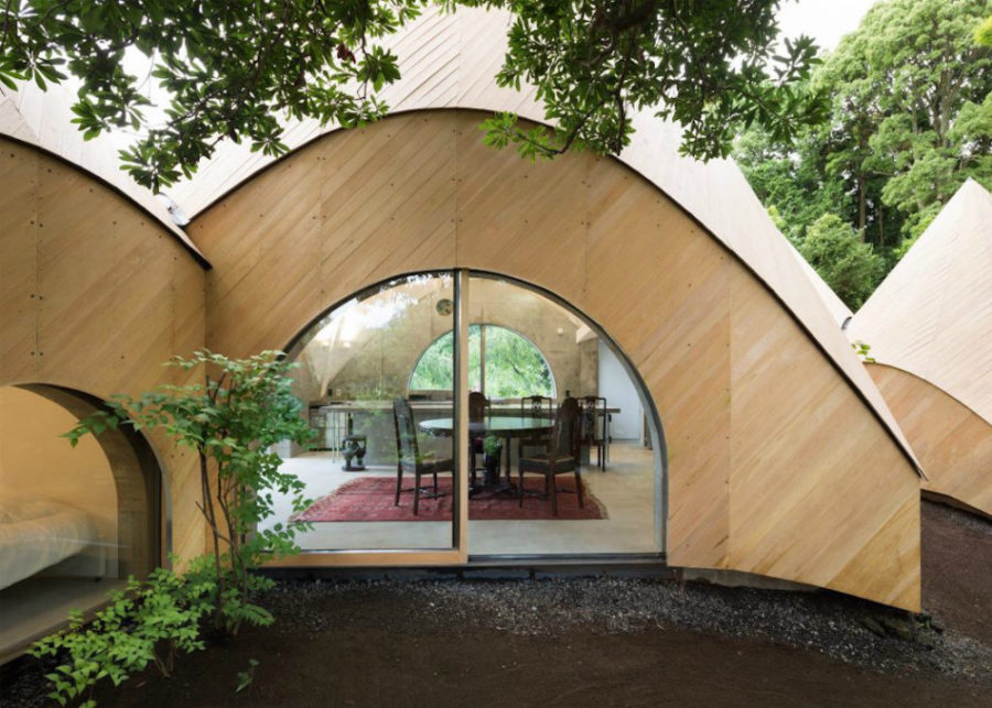 Arched glazed doors create a relationship between indoors and outdoors