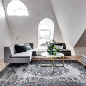 Attic Apartment in Stockholm Dictates Layout and Style