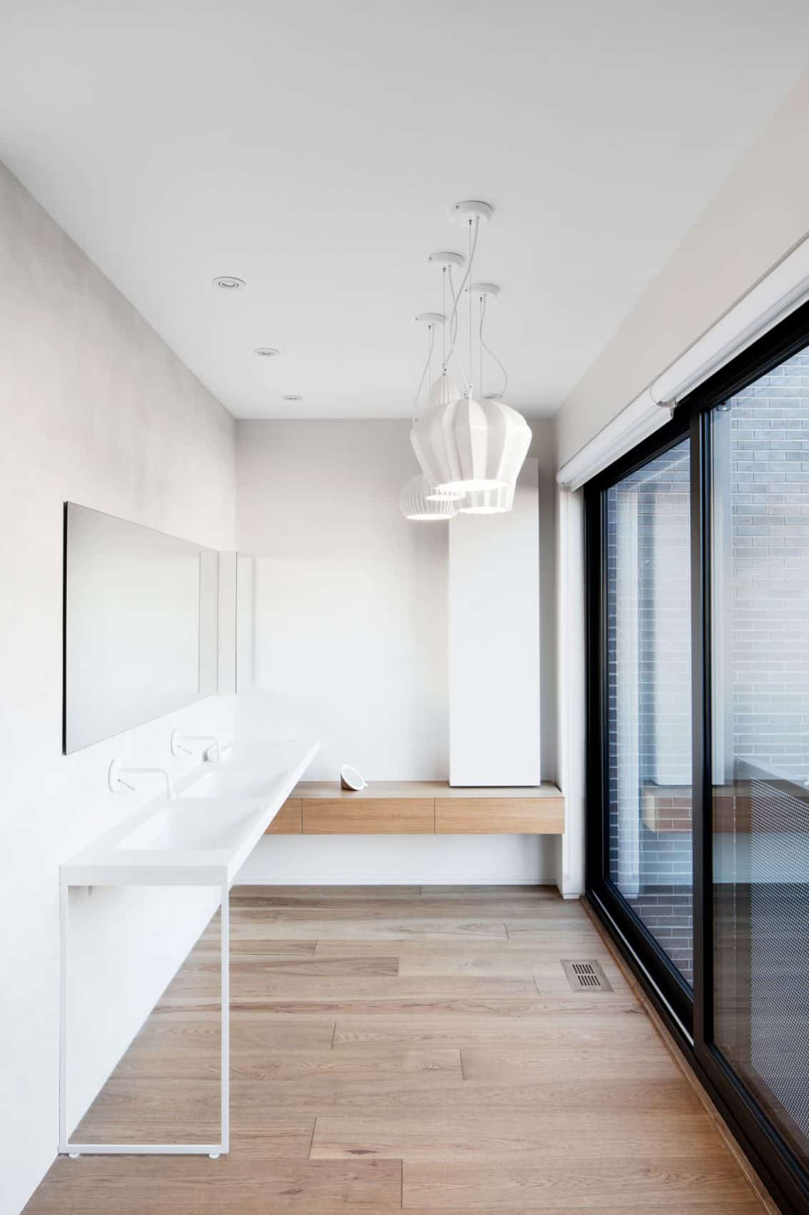 Bathroom decorated in white and wood
