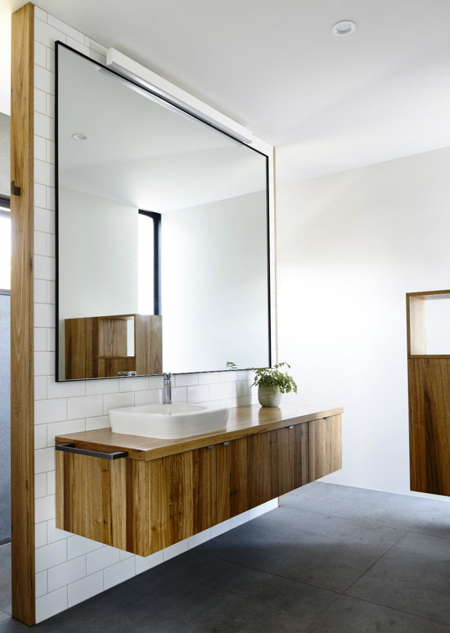 Bathroom vanity made of same wood as the kitchen