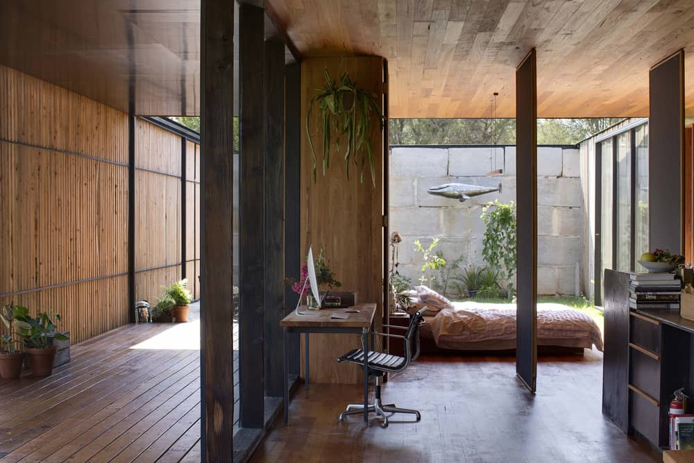 Bedroom located right behind the working area opens to both inner courtyard and the living room with pivoting walls