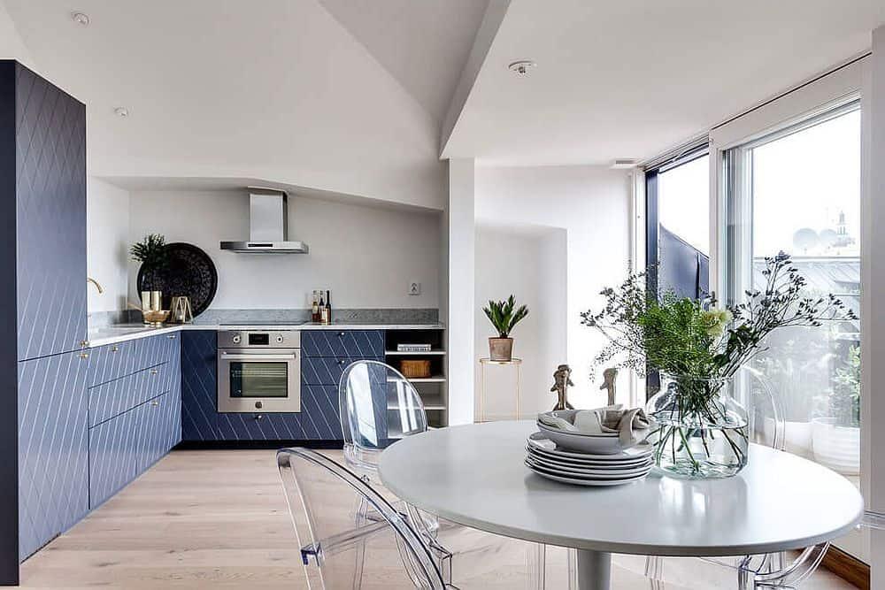 Blue kitchen cabinets are given a stylish pattern