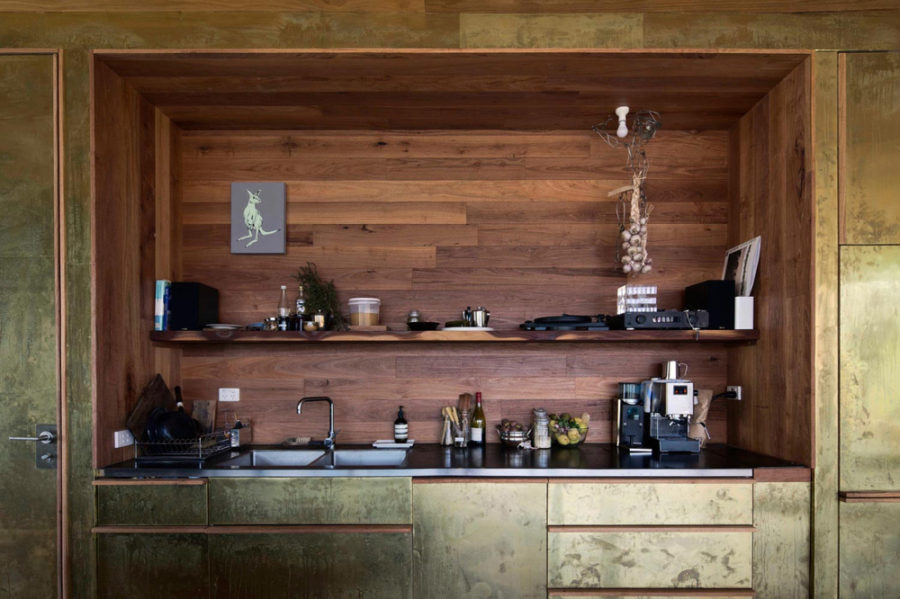Brass kitchen comes with a wooden backsplash