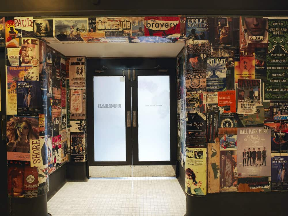 Colorful foyer plastered with magazine posters
