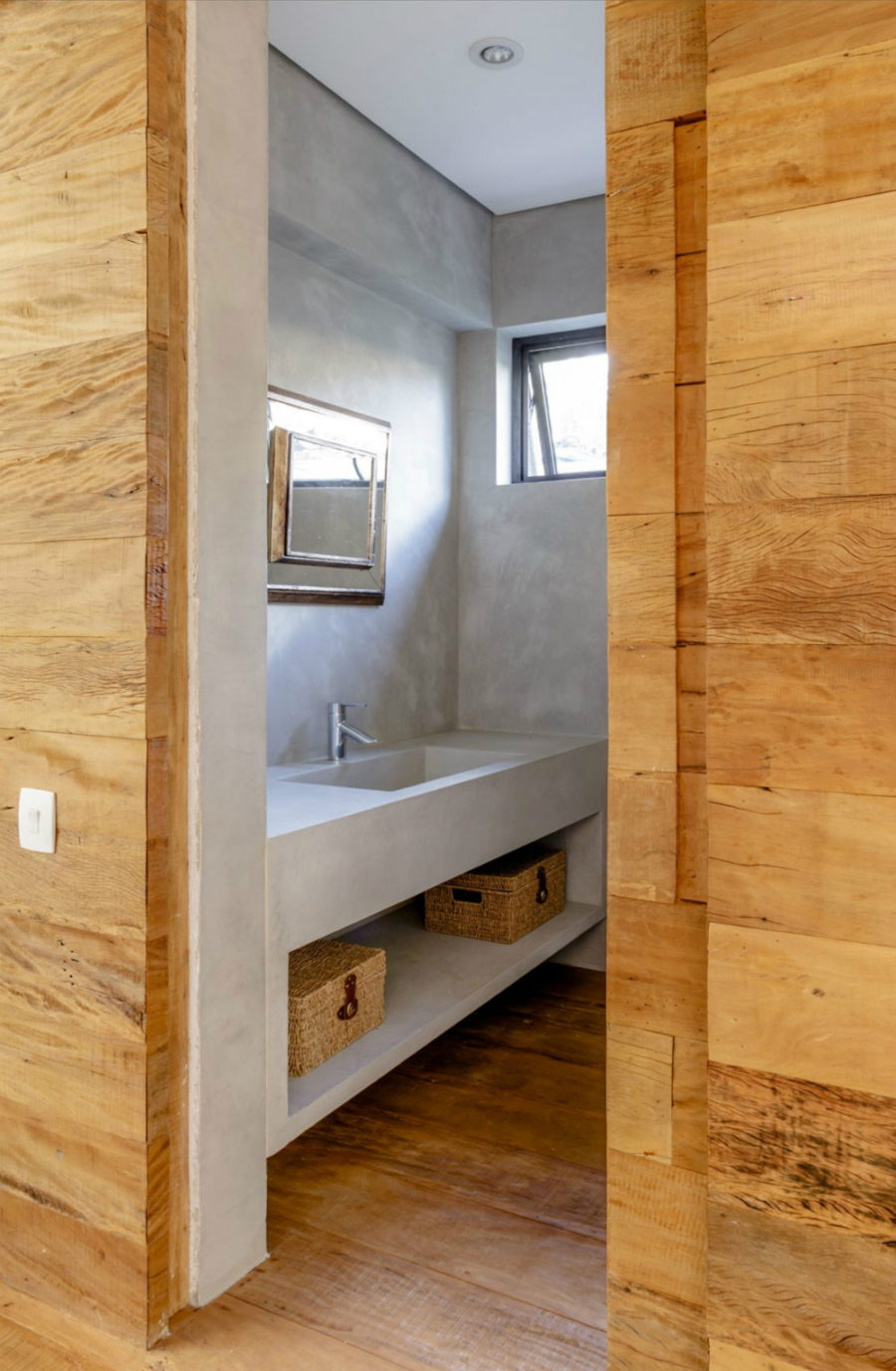 Concrete bathroom with a built-in vanity
