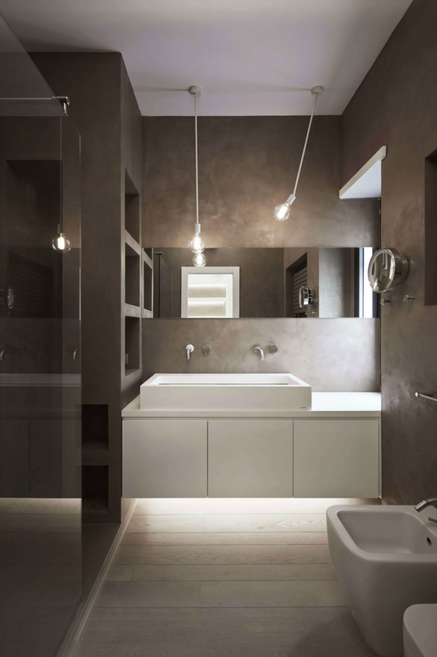 Concrete bathroom with white ambient lights