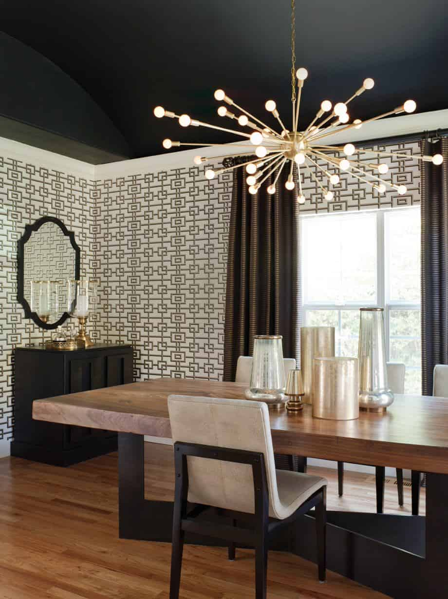 Contemporary black dining room with a sputnik chandelier