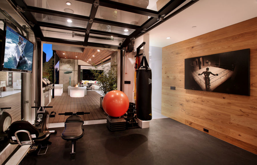 View In Gallery Contemporary Gym With A Garage Door