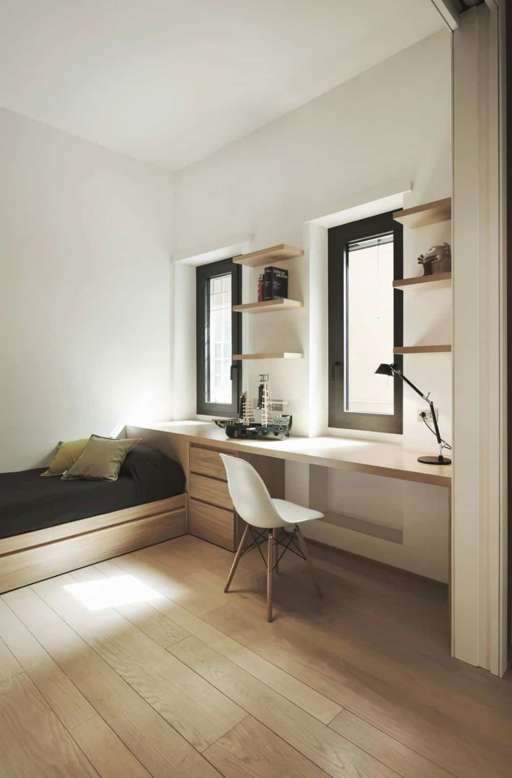 Contemporary kid's room with a built-in window desk
