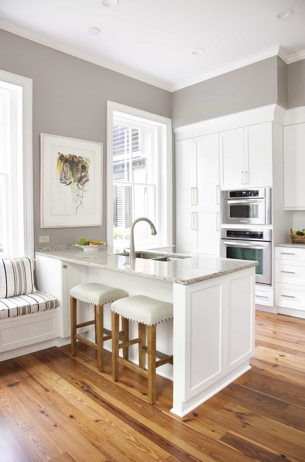 Elegant kitchen peninsula with a built-in window seat