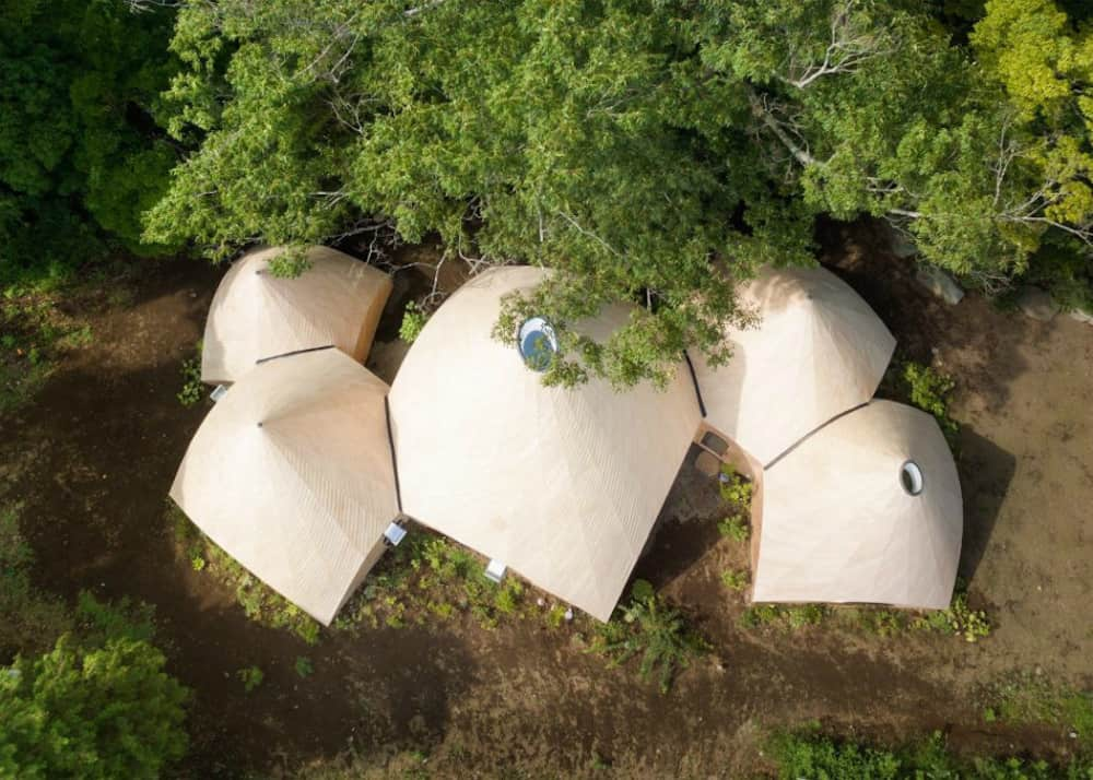 Five teepee-shaped buildings by architect Issei Suma make up the complex