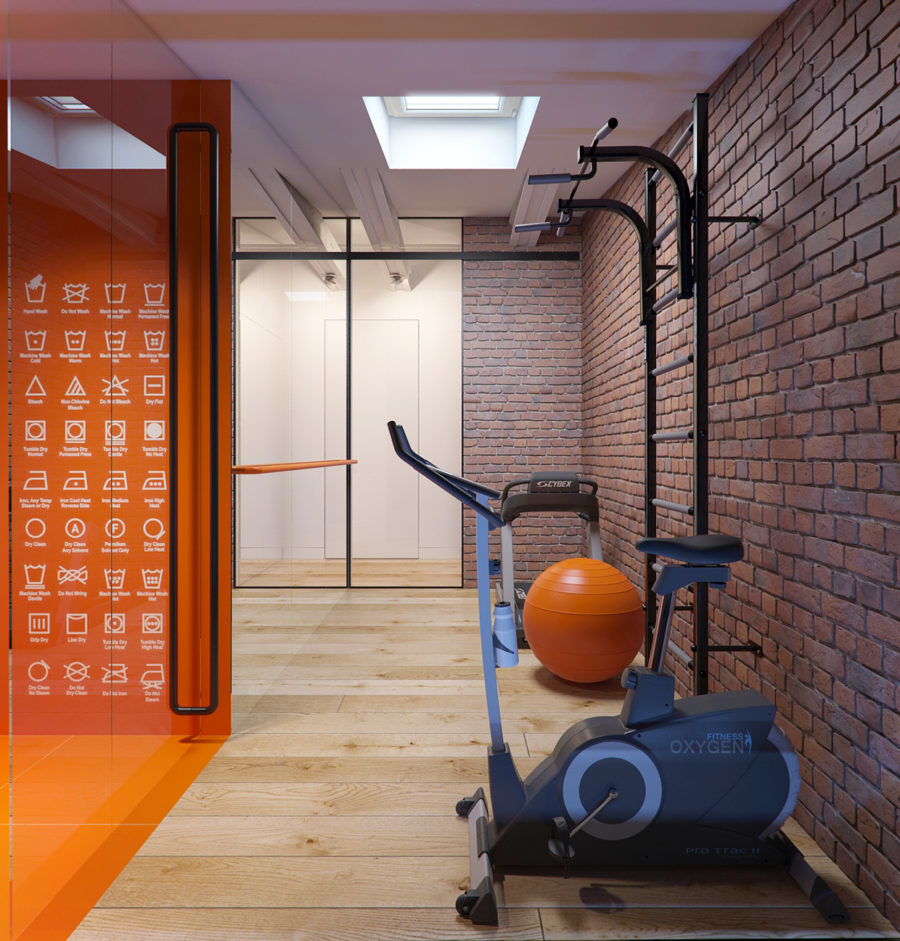 Home gym with exposed brick