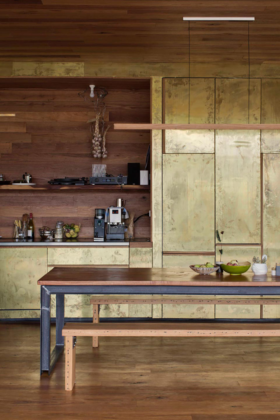 Kitchen cabinets are covered with brass