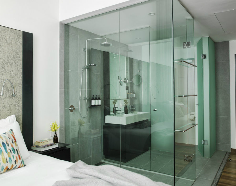 Room with a glass-enclosed bathroom