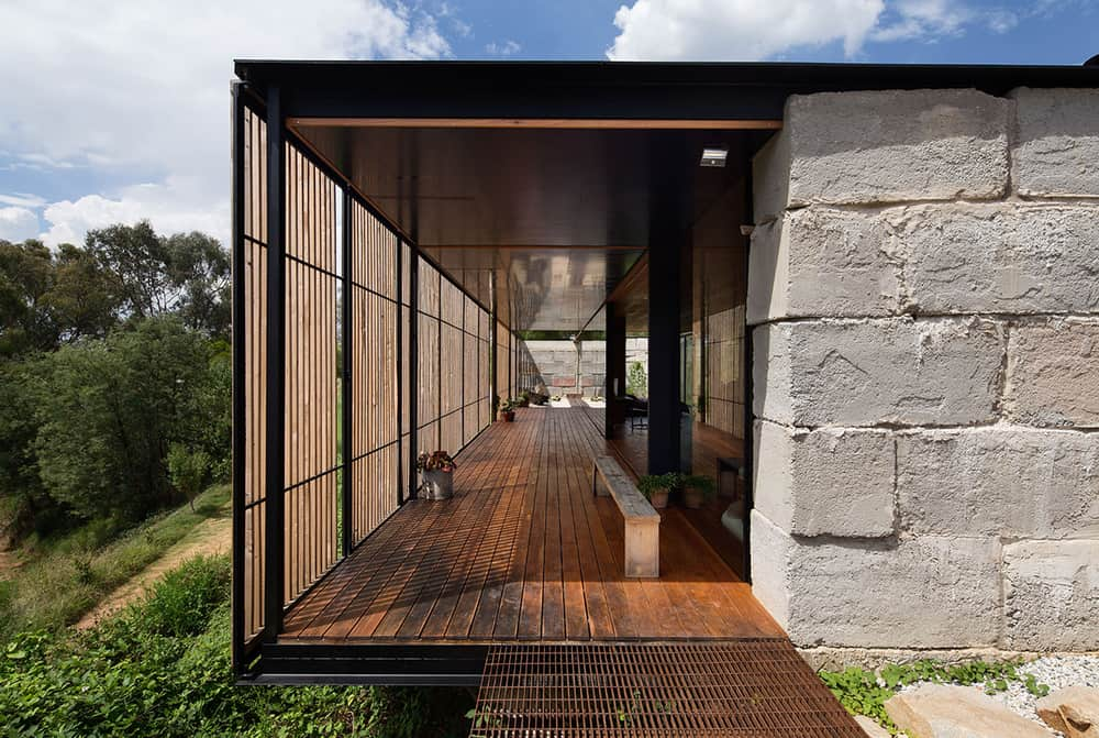 Screened terrace is an integral part of the house