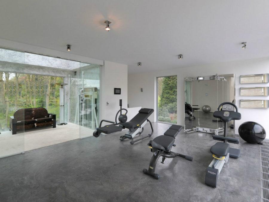 Sleek gym with concrete floors