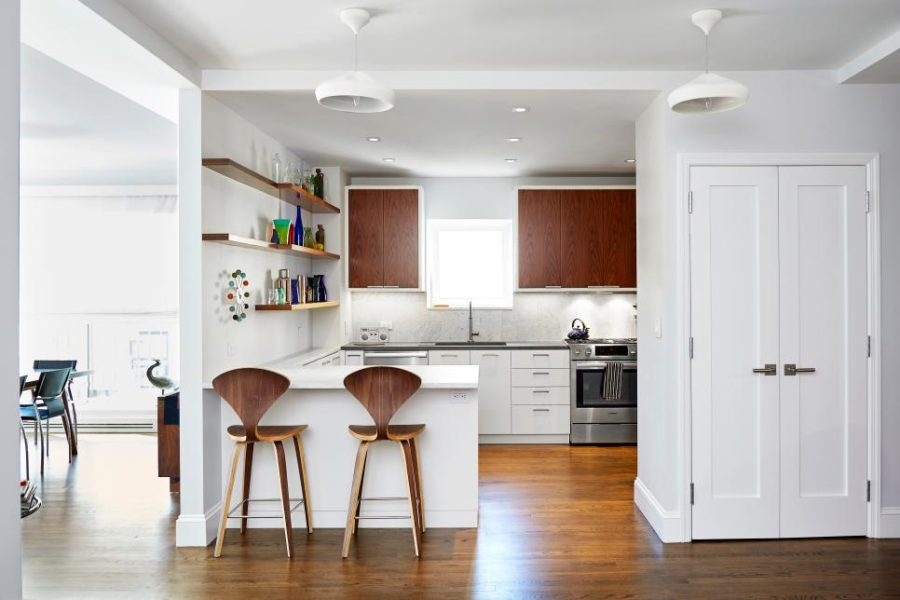 Small modernist kitchen peninsula by Lauren Rubin Architecture