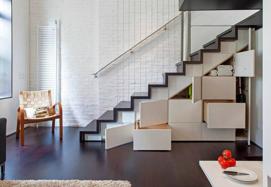 Staircase hidden storage by Specht Architects
