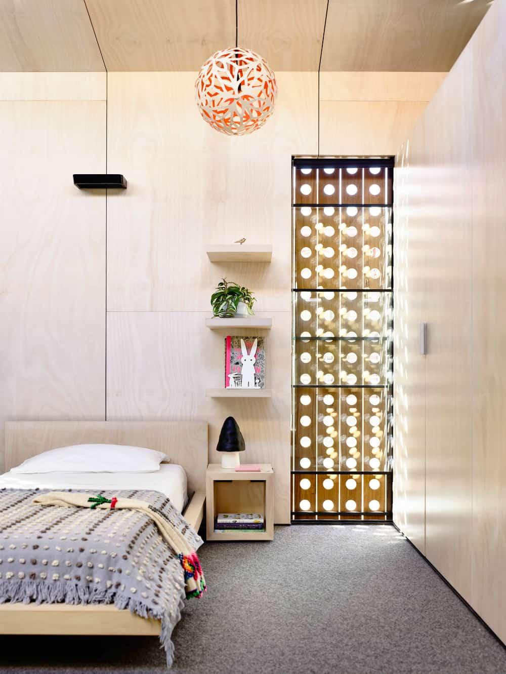 Stylish wood-clad kids room