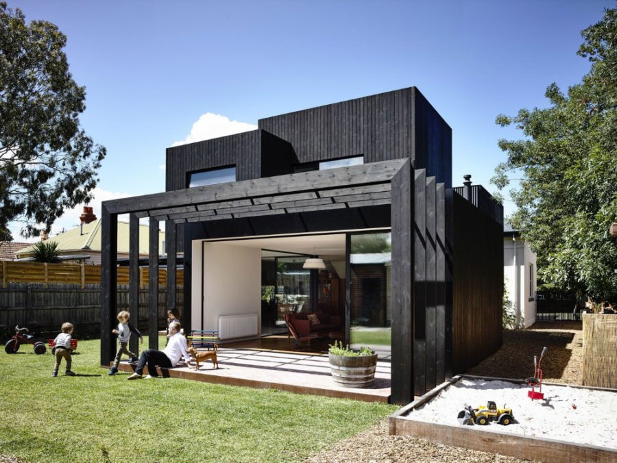 The building structure creates a covered a backayrd terrace