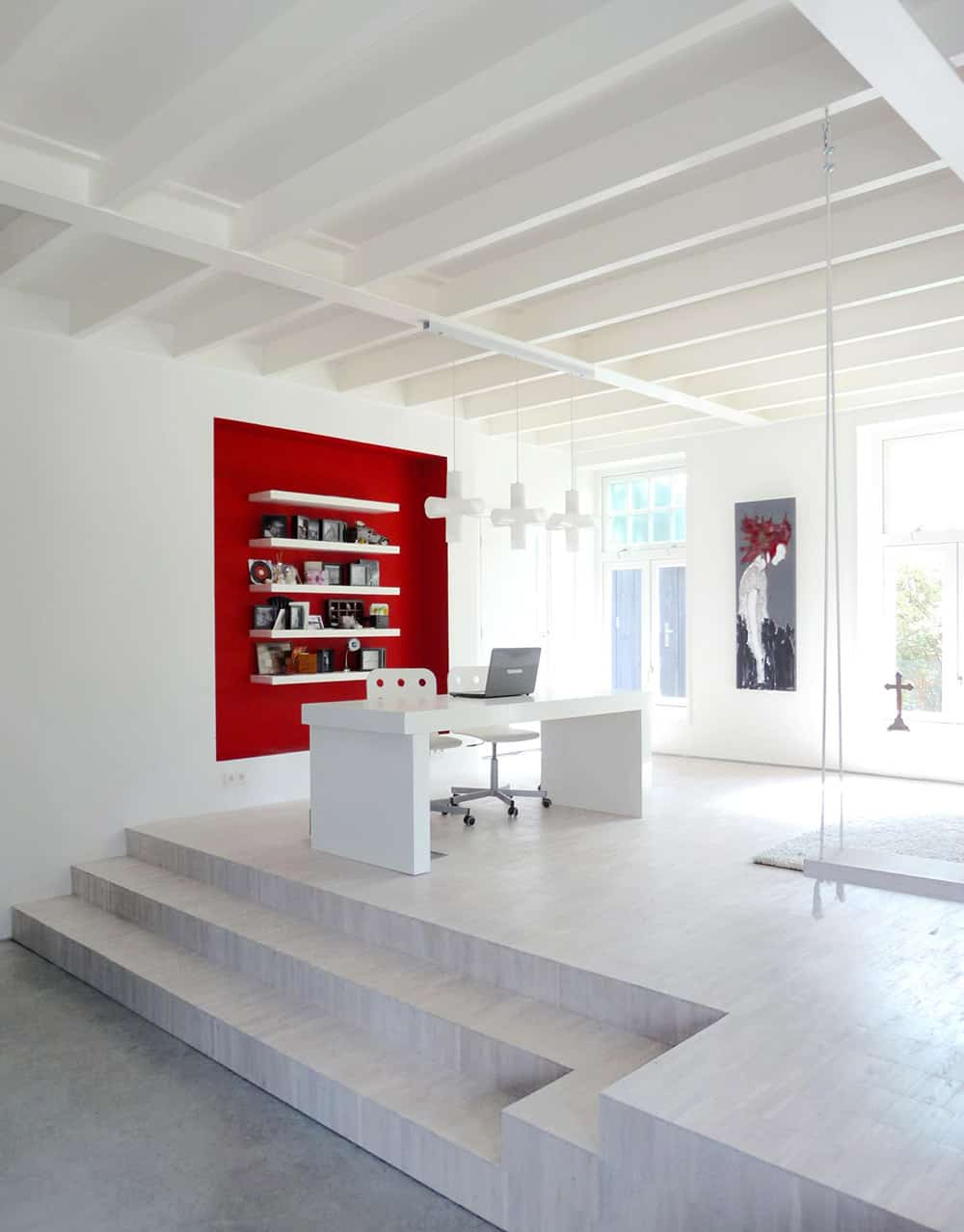 White home office with red accent and swing