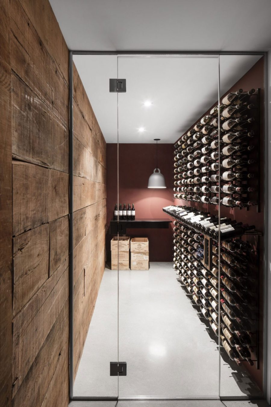 Wine cellar in a small room with a glass door