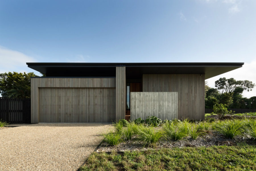 Wood-clad walls give the house privacy