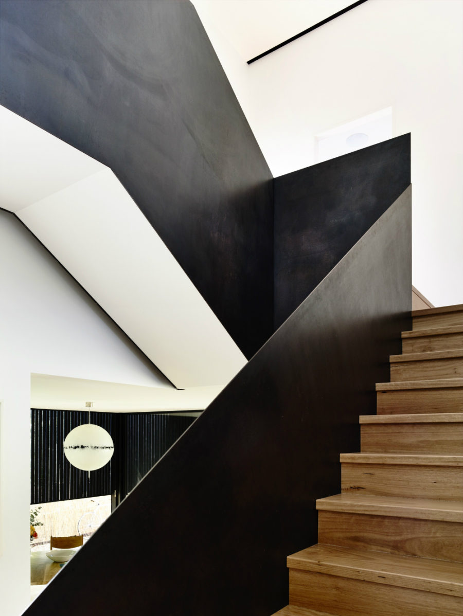 Wooden staircase comes with metal railing