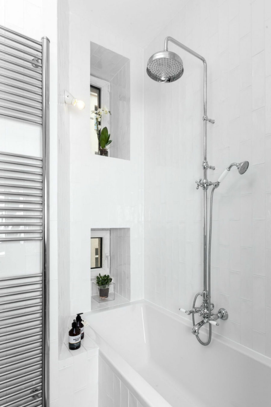 A bathtub also has a shower