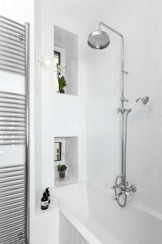 A bathtub also has a shower