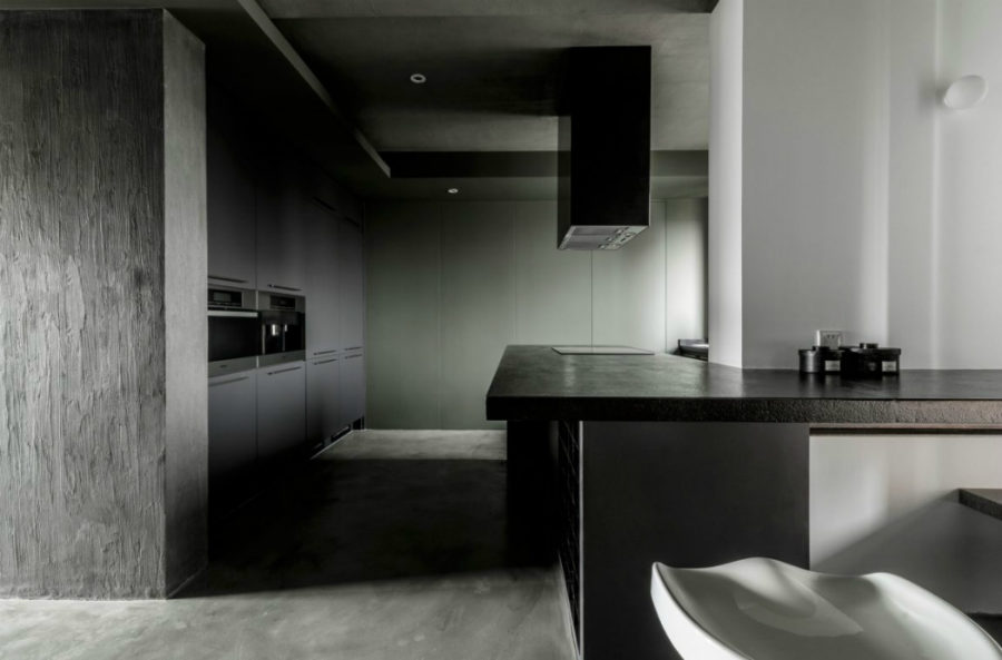 A dark kitchen comes in minimalist style