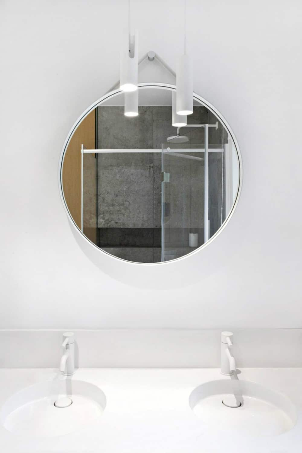 A hanging round mirror looks most contemporary