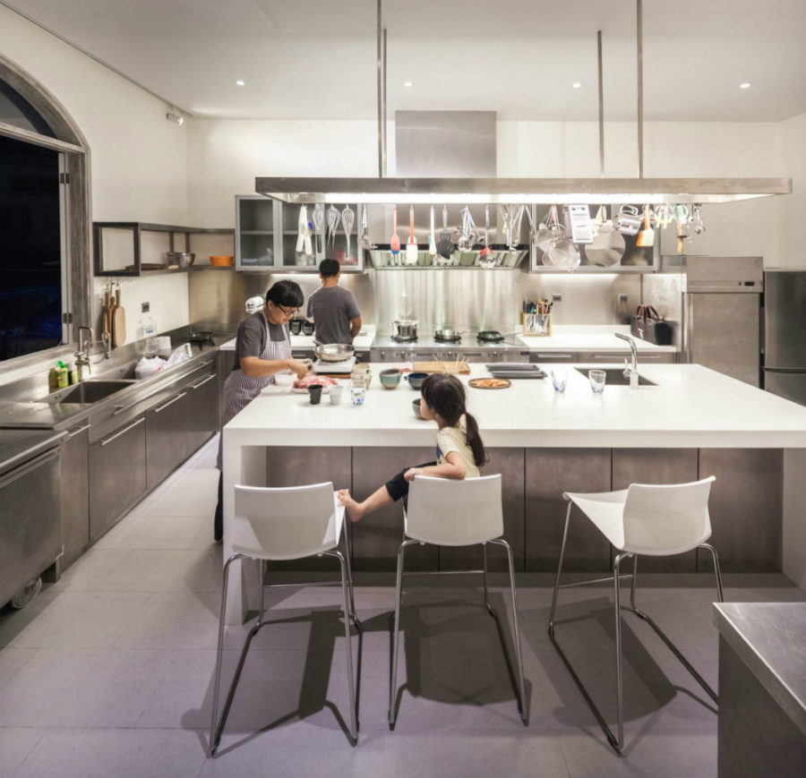 A massive kitchen island allows plenty of working space