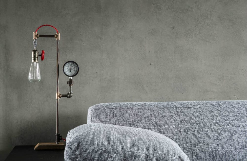 A side table lamp adds an unexpected industrial touch to the contemporary home