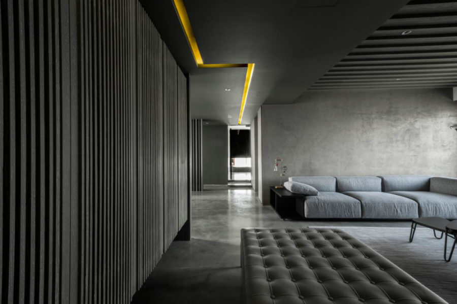 An inbuilt yellow light runs through the ceiling to accentuate the monochromatic interior 900x599 Monochromatic Private Home in Shanghai Uses Concrete as Color Base