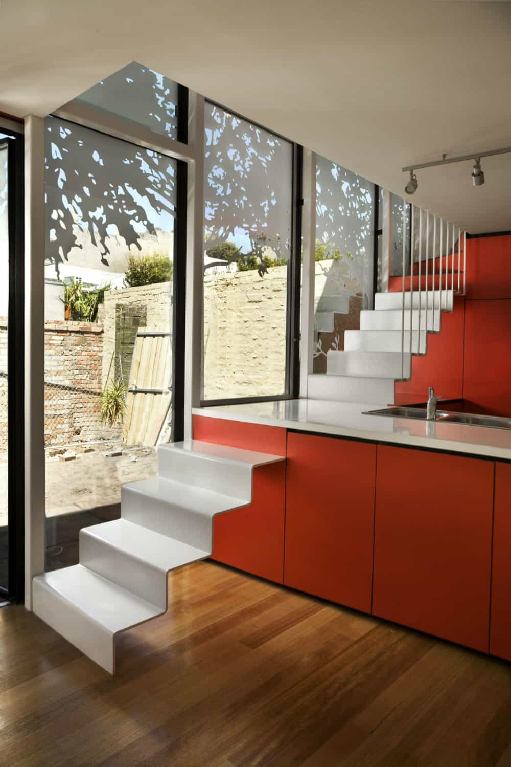 Andrew Maynard Architects put a staircase through the kitchen island
