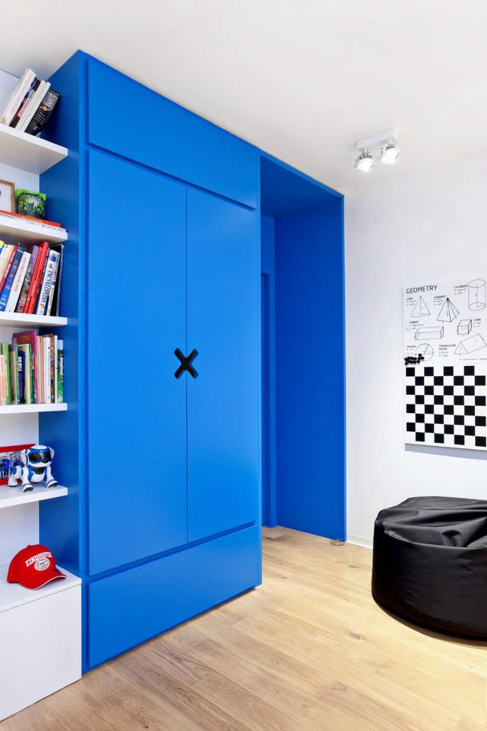 Bright blue closet makes for another bright element in a white room
