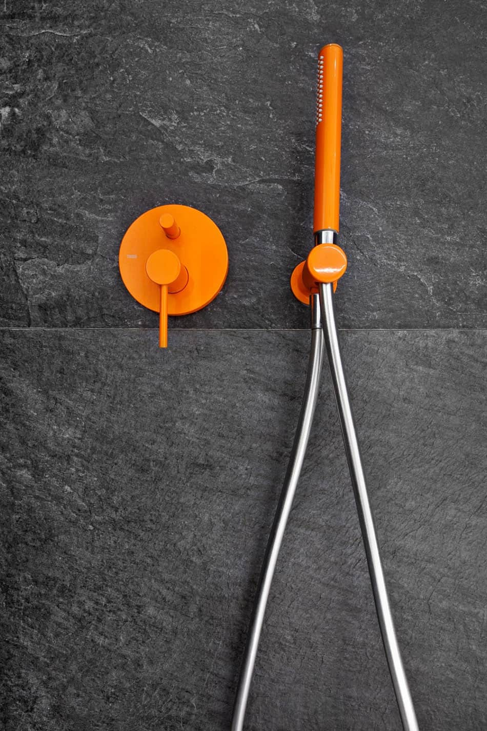 Bright orange hardware accents give more pop to the contrasting color scheme
