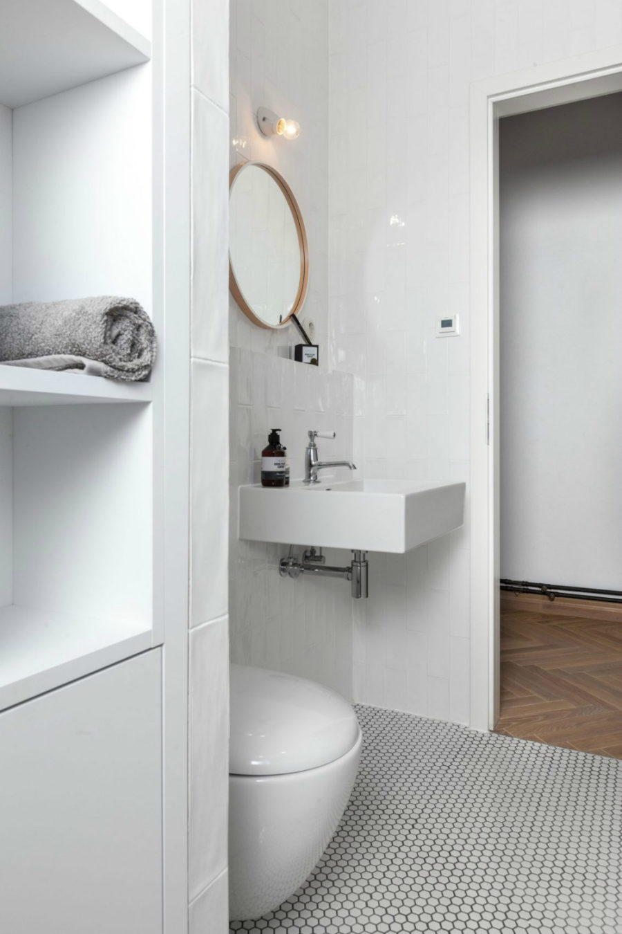 Built-in storage keeps the pristine bathroom neat