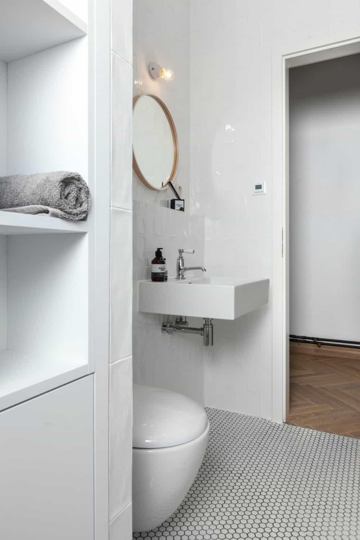 Built-in storage keeps the pristine bathroom neat