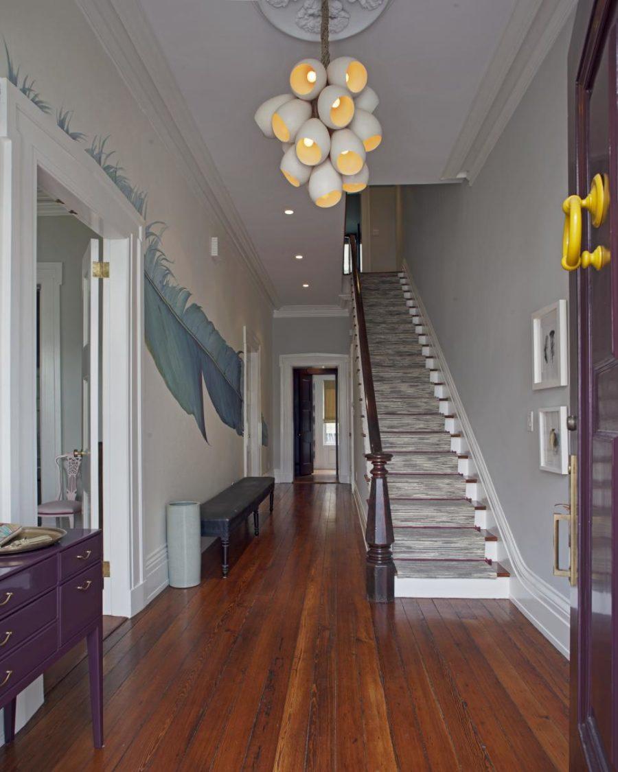 Colorful modern foyer by Rethink Design Studio